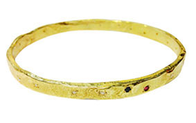 gold reticulated diamonds, ruby and sapphire bangle