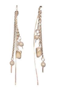Colette Hazelwood Contemporary Jewellery silver baby teeth earrings
