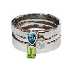 white gold, topaz, peridot and diamond stacking rings