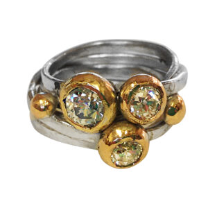 silver and gold wrap ring by Colette Hazelwood Contemporary Jewellery.