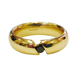yellow gold ring with black diamond by Colette Hazelwood Contemporary Jewellery.