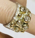 textured ring with gold and diamonds