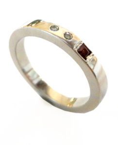 Colette Hazelwood Contemporary Jewellery. Platinum, Diamonds and Garnet Ring