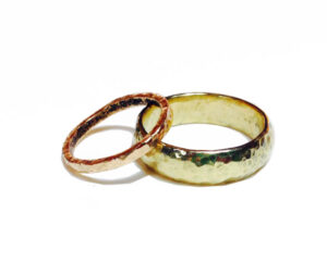 red and yellow gold hammered wedding rings by Colette Hazelwood Contemporary Jewellery.