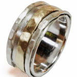 silver and gold spinning rings by Colette Hazelwood