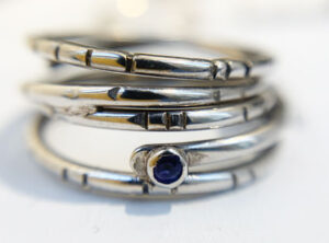 white gold and tanzanite wrap ring by Colette Hazelwood Contemporary Jewellery.