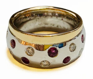 Colette Hazelwood contemporary jewellery, white and yellow gold ring renmake with rubies and diamonds