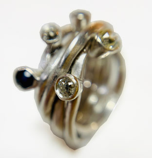 Colette Hazelwood Contemporary Jewellery.silver wrap ring with diamonds and sapphires