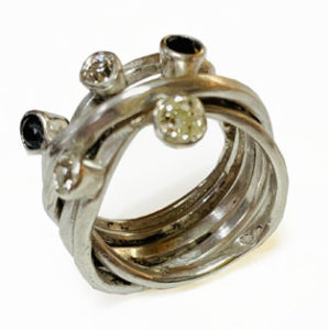 Colette Hazelwood contemporary jewellery, silver wrap ring with diamonds and sapphires