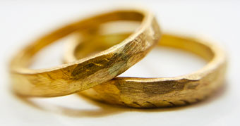 Gold hammered wedding rings by Colette Hazelwood Contemporary Jewellery