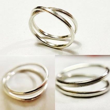 Colette Hazelwood Contemporary Jewellery, white gold infinity ring.