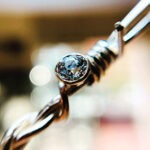 gold barb wire pendant with diamond
