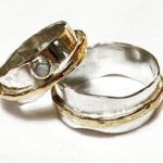 silver, gold and opal rings recycled