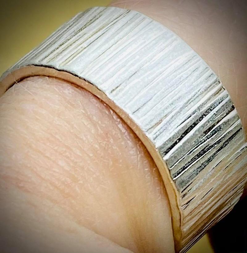 bark hammered ring polished close up